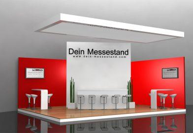 Messestand mit weißem Mobiliar - Stehtisch, hohen Stühlen und roter Wand.